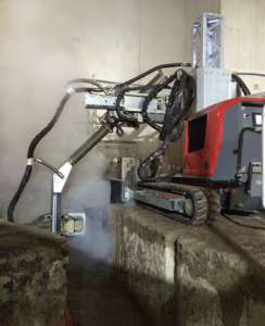 Hydrodemolition-robot-tackles-concrete-hydroblasting-with-over-edge-arm-attachement.png