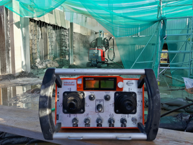 Remote-controlled-robotic-concrete-hydrodemolition-of-wall.png