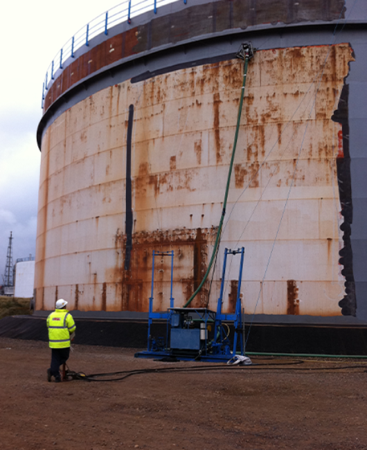 Steel-surface-preparation-and-paint-removal-of-petrochemical-tank-using-vaccum-attached-limpet.png