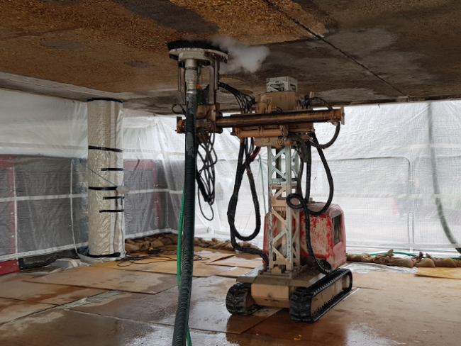 concrete-surface-preparation-of-ceiling-with-water-jetting-robot.png